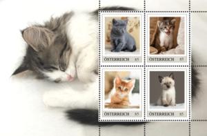 Niedliche Kätzchen auf Briefmarken